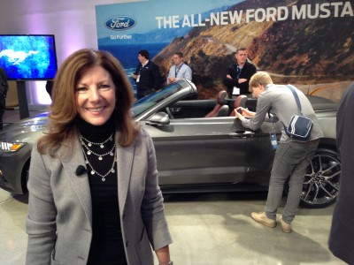 Design engineer Marcy Fisher in front of her baby, the 2015 Mustang, looking very proud (and, she should!)