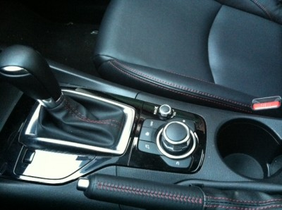 Mazda's center console has room for drinks, keys and sunglasses