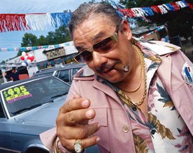 Car salesman;   Photo: UpgradedMedia