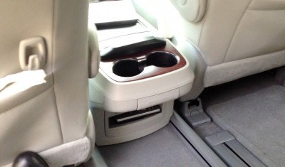Center row seats offer lots of legroom and the console, which slides back to accommodate center row passengers, features a household plug and A/V ports.
