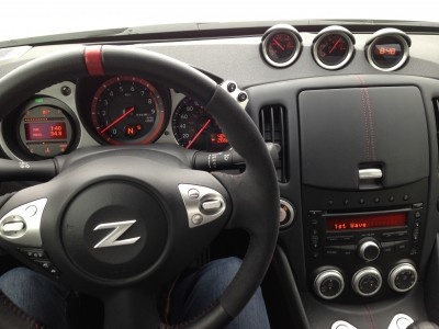 A cabin outfitted with just what you need: controls on the steering wheel allow hands free phone and easy radio tuning; gauges are neatly displayed.