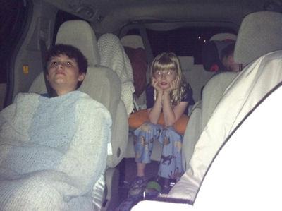 Kids in Van watching Movie
